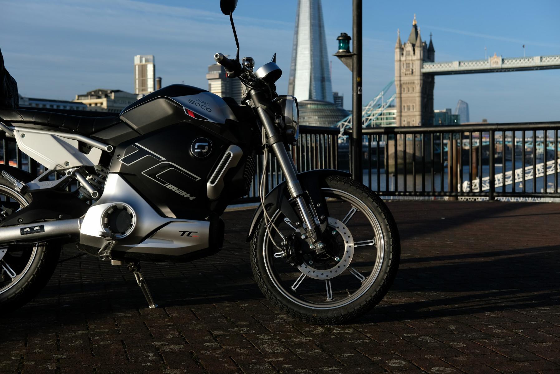 Super Soco TC Max electric motorcycle London Tower Bridge
