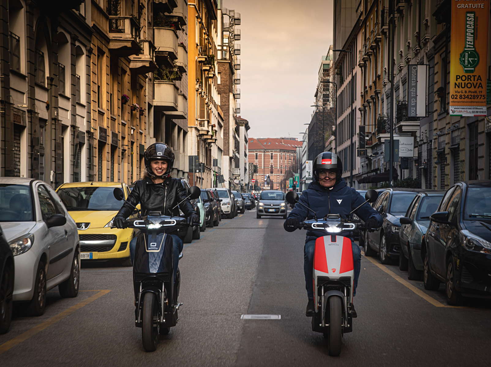Super Soco CUx electric scooter Ducati Edition being ridden in Milan