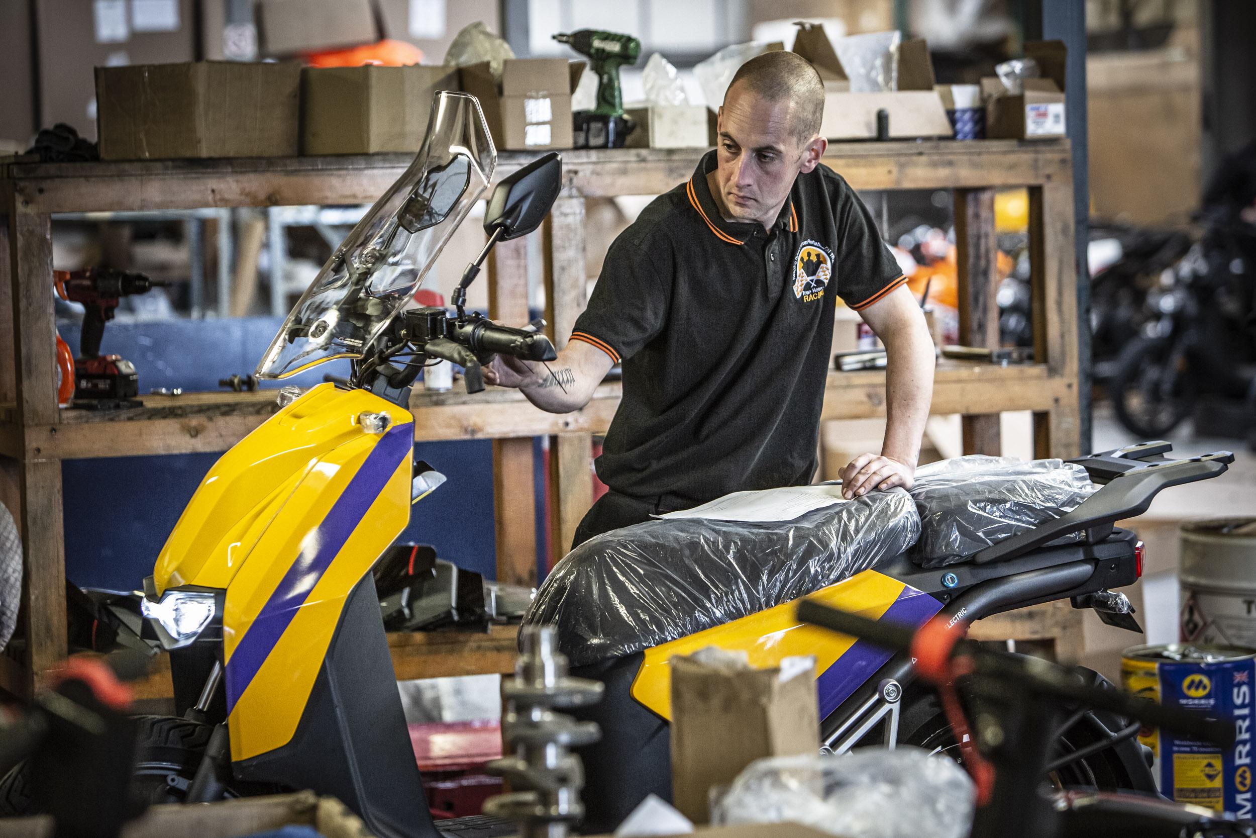 Nathan of True Heroes Racing working for Super Soco UK