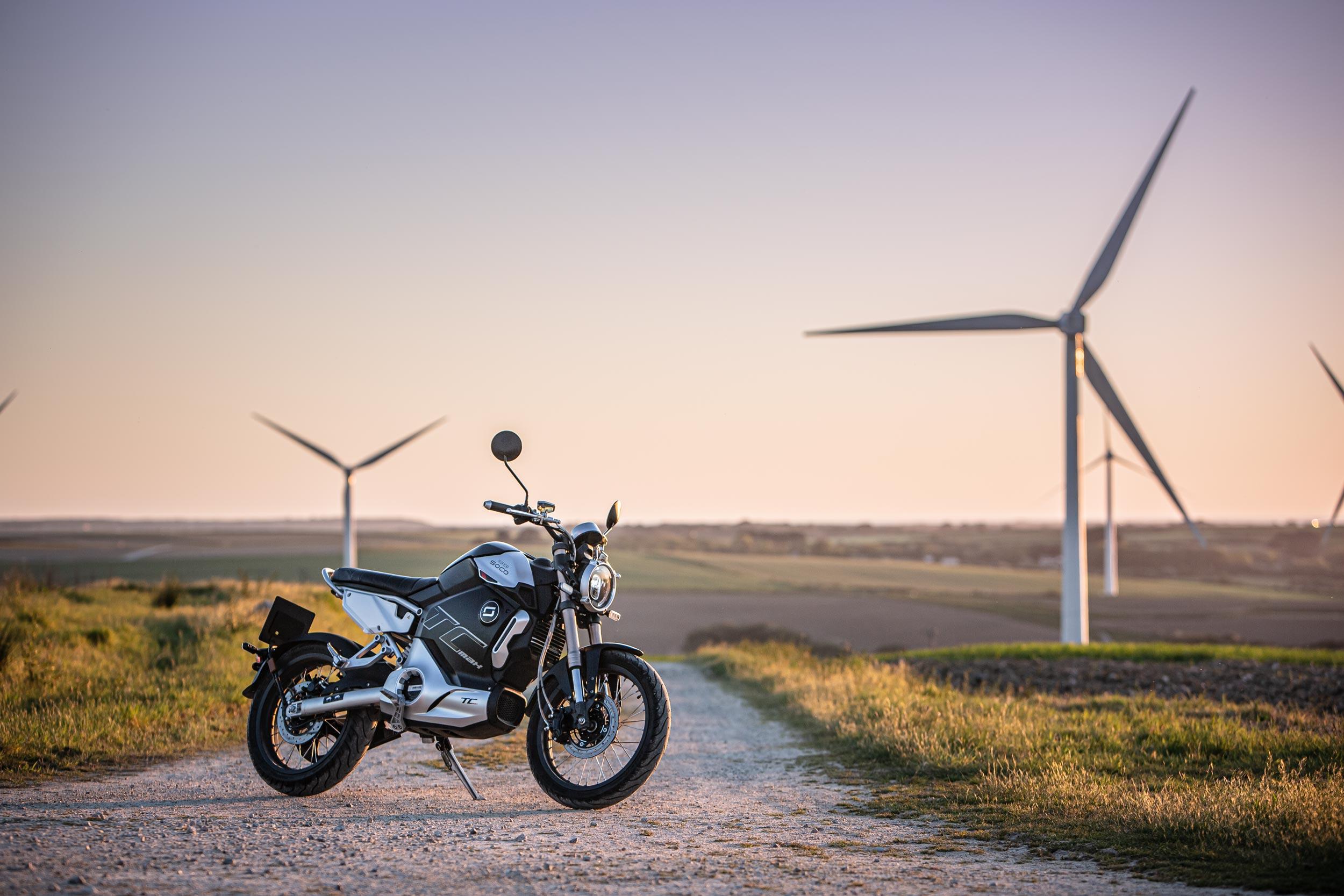 Super Soco TC Max photographed at a wind farm